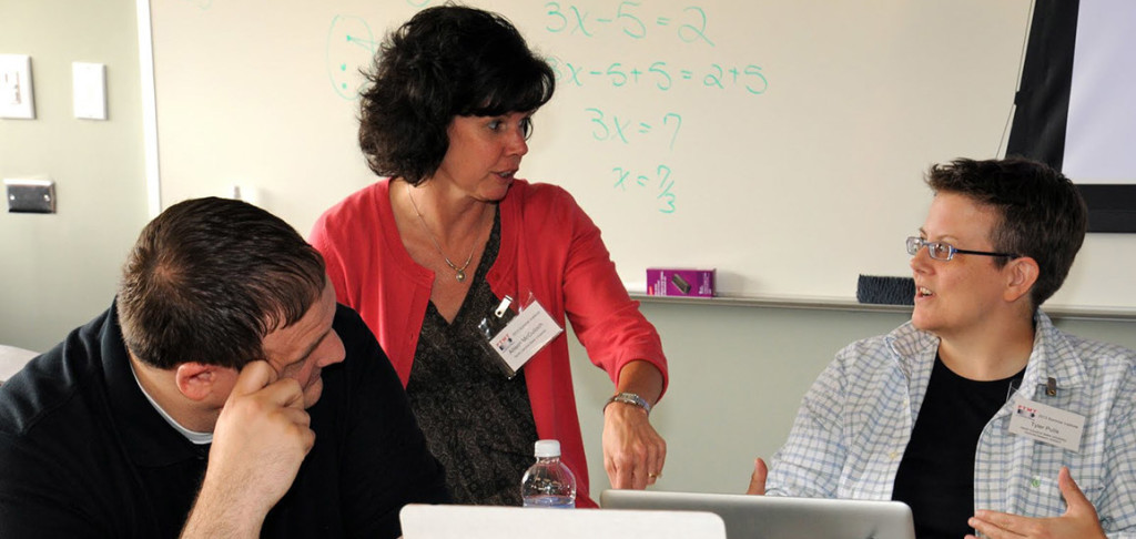 Allison McCulloch and two math instructors discussion how to incorporate technology in solving equations.
