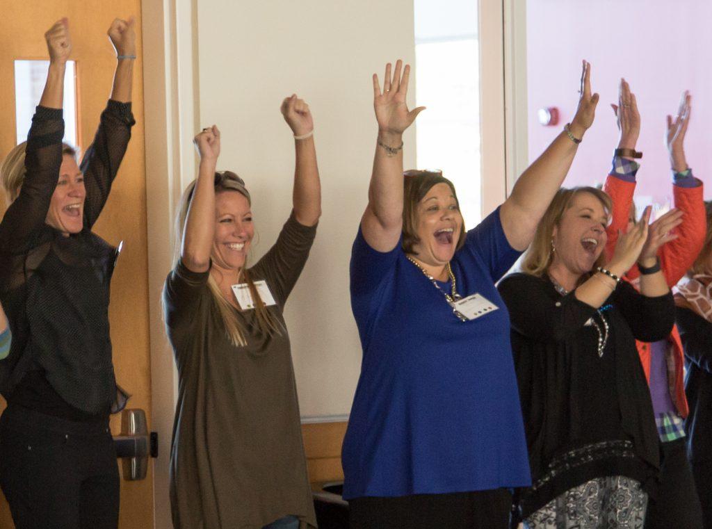 Educators cheer at a gathering of the NC Digital Leaders Coaching Network cohort.