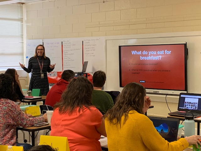 Researcher Dr. Emily Thrasher leads a presentation in a classroom for Sampson County educators.