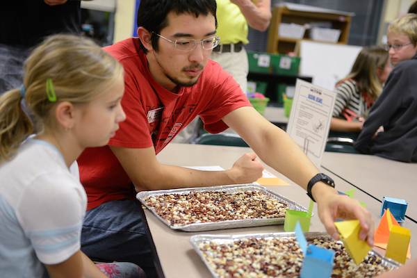 NC State Goodnight scholars interact with students at a Science night at a local elementary school. Photo by Marc Hall